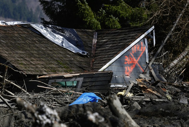 orange X on a house, destroyed in the Snohomish mudslide, indicates it has been searched for people