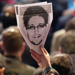 In Brazil activists hold up pics of Ed Snowden