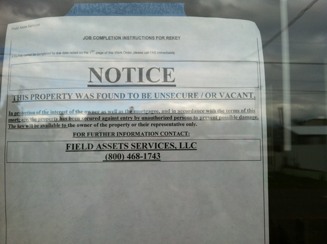 legal notice taped to a window on a cottage at Snoozy's Hollow in Northeast Portland