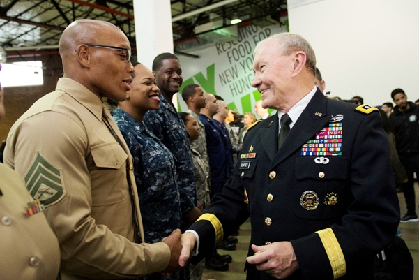 Gen Martin Dempsey shakes hands with soldiers