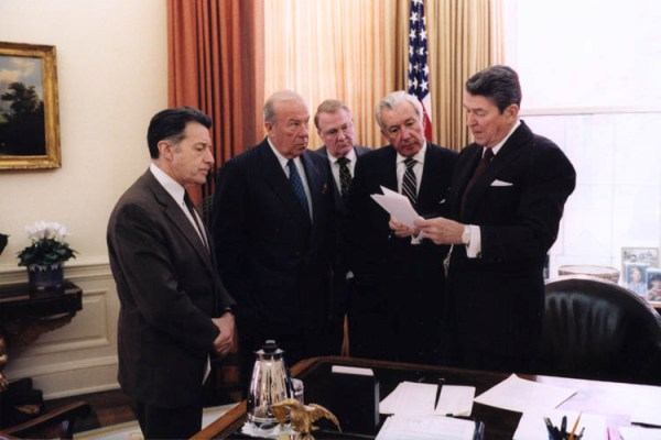 President Reagan talks to his aides about the Iran Contra scandal
