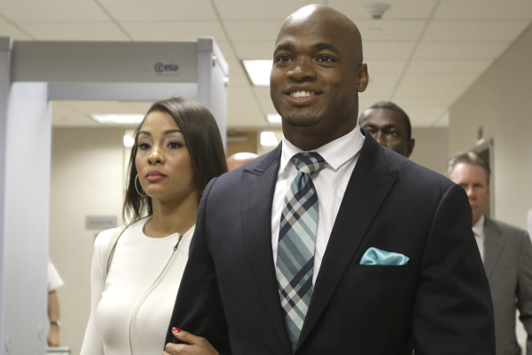 Adrian Peterson and wife