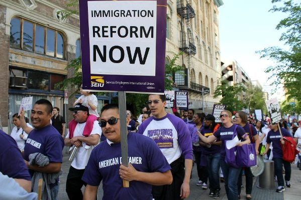 Immigrants rights groups marched with signs demanding immigration reform on May 1, 2013
