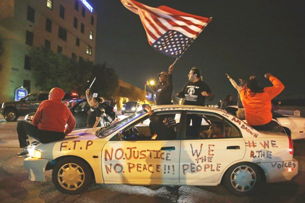 Protesters block street with car in St Louis, Mo.