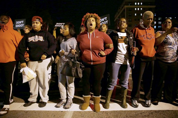 Women protest the police shooting of Vonderrit D. Myers