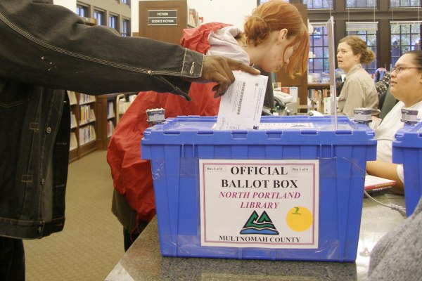 Portland resident Harry P. Henderson votes for the very first time in his life, at the North Portland Library on Nov. 4. 2008