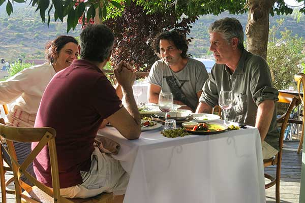 Anthony Bourdain enjoying a meal with guests