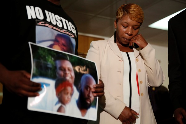 Lesley McSpadden cries after shooting of her son Michael Brown