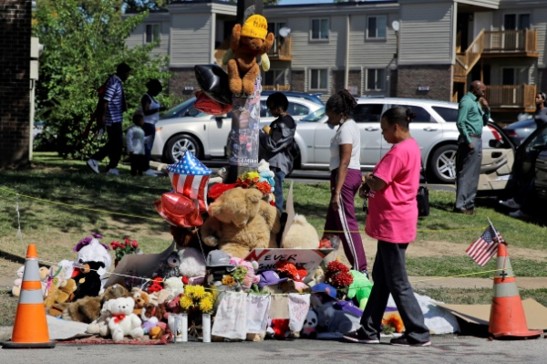 A memorial for Michael Brown was burned down but has been replaced