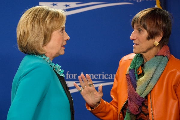 Hillary Clinton speaks to Rep. Rosa DeLauro, D-Conn.