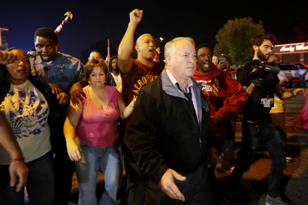 Ferguson Mo. police chief Tom Jackson begins to march with protesters before clashes led to arrests
