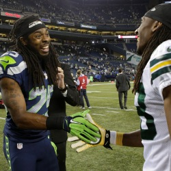 Richard Sherman shakes hands with Green Bay cornerback