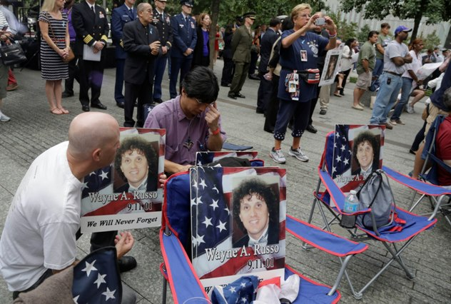 Brian Sommer and Lito Deleon hold photos of their friend Wayne Russo, who died in the Sept 11, 2001 attacks