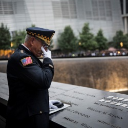 Sam Pulia, mayor of Westchester, Ill. mourns over the name of his cousin, New York firefighter Thomas Anthony Casoria, who was killed in the South Tower on Sept. 11, 2001