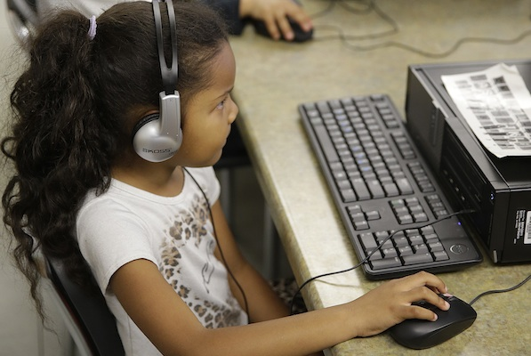 First-grade student learns to keyboard as part of Common Core standard curriculum