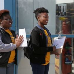 Clark Atlanta University students talk with a Ferguson, Mo voters