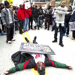 Demonstrators protest in the streets of Baltimore