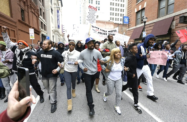 Protestors march for Freddie Gray through downtown Baltimore