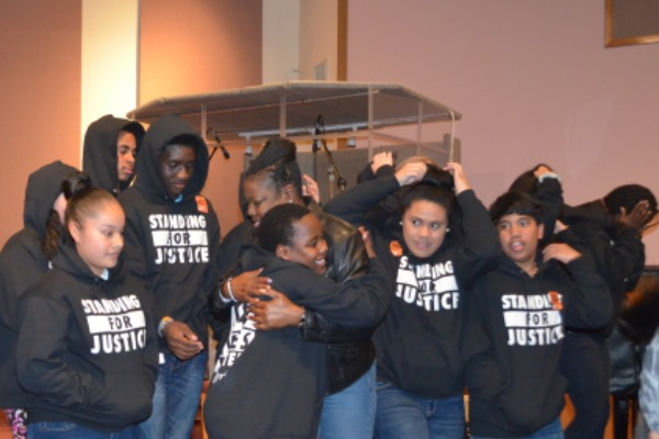 Trayvon Martin's mom Sybrina Fulton hugs a youth from Ockley Green