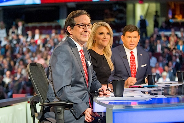 Fox News moderators from left, Chris Wallace, Megyn Kelly and Bret Baier speak to the camera before Republican presidential candidates New Jersey Gov. Chris Christie, Sen. Marco Rubio, R-Fla., Ben Carson, Wisconsin Gov. Scott Walker, Donald Trump, former Florida Gov. Jeb Bush, former Arkansas Gov. Mike Huckabee, Sen. Ted Cruz, R-Texas, Sen. Rand Paul, R-Ky., and Ohio Gov. John Kasich take the stage for the first Republican presidential debate at the Quicken Loans Arena, Thursday, Aug. 6, 2015, in Cleveland. (AP Photo/Andrew Harnik)
