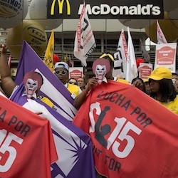 Demonstrators protest for better wages and working conditions for McDonald's employees, in Sao Paulo, Brazil, Tuesday, Aug. 18, 2015. The protest gathered McDonald's workers, union representatives from 20 countries, and members of the Restaurant Workers Union. (AP Photo/Andre Penner)