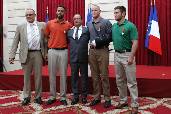 British businessman Chris Norman, Anthony Sadler, a senior at Sacramento University in California, French President Francois Hollande, U.S. Airman Spencer Stone, and Alek Skarlatos a U.S. National Guardsman from Roseburg, Oregon pose at the Elysee Palace, Monday Aug.24, 2015 in Paris, France. Hollande pinned the Legion of Honor medal on U.S. Airman Spencer Stone, National Guardsman Alek Skarlatos, and their years-long friend Anthony Sadler, who subdued the gunman as he moved through the train with an assault rifle strapped to his bare chest. The British businessman, Chris Norman, also jumped into the fray. (AP Photo/Michel Euler, Pool)