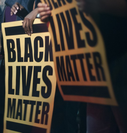 Black Lives Matter banners held by demonstrators
