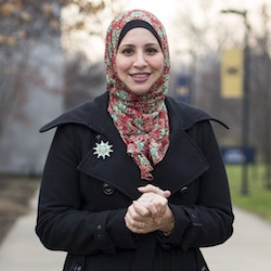 PHOTO: Suehaila Amen, coordinator of International Admissions and Recruitment at the University of Michigan Dearborn, is seen on campus, Thursday, Dec. 10, 2015 in Dearborn, Mich. Amid the high level of harassment, threats and vandalism directed at American Muslims and at mosques, Muslim women are intensely debating the duty and risks related to wearing their head-coverings as usual. (AP Photo/Tim Galloway)