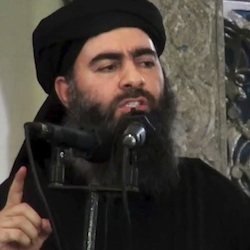 "This file image made from video posted on a militant website Saturday, July 5, 2014, purports to show the leader of the Islamic State group, Abu Bakr al-Baghdadi, delivering a sermon at a mosque in Iraq during his first public appearance. The Islamic State group has released a new message purportedly from its reclusive leader, claiming his self-styled ""caliphate"" is doing ""well"" despite an unprecedented alliance against it. (AP Photo/Militant video, File)"