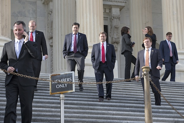 Members of the House of Representatives leave Capitol Hill in Washington, Friday, Dec. 11, 2015, after a voice vote to approve a short-term spending bill to keep the government open and avoid a crisis when the current budget expires at midnight. Today's vote extends that deadline through Wednesday, Dec. 16, 2015, to allow more time for talks as lawmakers and the White House rush to finalize a $1.1 trillion government-wide spending bill and a sprawling tax package. (AP Photo/J. Scott Applewhite)