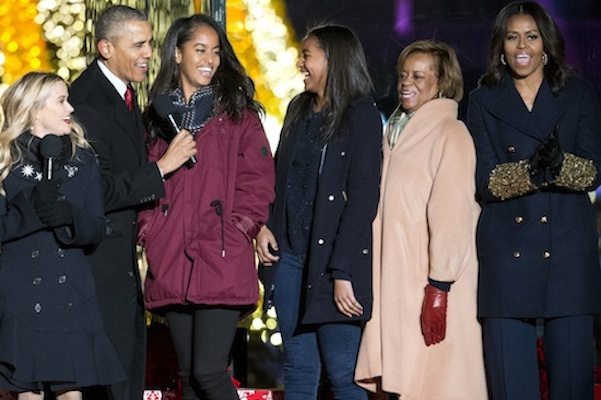President Barack Obama, left, with daughters Malia and Sasha, mother-in-law Marian Robinson and first lady Michelle Obama sing onstage during the National Christmas Tree Lighting ceremony at the Ellipse in Washington, Thursday, Dec. 3, 2015. Also on stage is actress Reese Witherspoon at left. (AP Photo/Pablo Martinez Monsivais