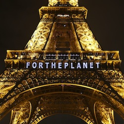 "The slogan ""FOR THE PLANET"" was one of several that were projected on the Eiffel Tower as part of the COP21, United Nations Climate Change Conference in Paris, France, Friday, Dec. 11, 2015. (AP Photo/Francois Mori)"