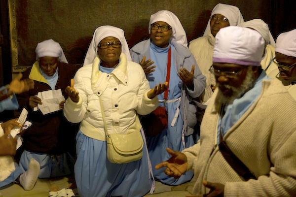 Christian pilgrims from Nigeria pray inside the Grotto of the Church of the Nativity, traditionally believed by Christians to be the birthplace of Jesus Christ, in the West Bank city of Bethlehem on Christmas Eve, Thursday, Dec. 24, 2015. (AP Photo/Majdi Mohammed)