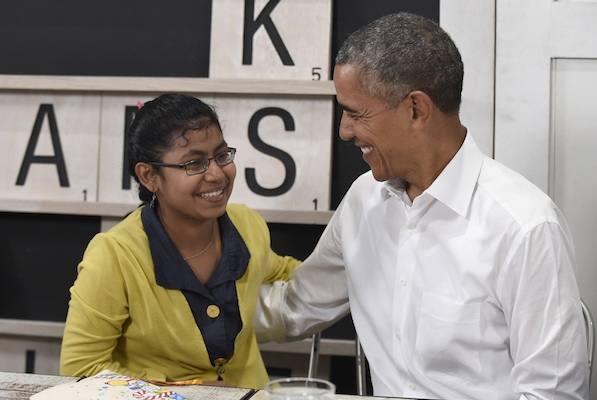 President Barack Obama and a 16-year-old refugee from Myanmar smile at each other upon getting a hug from her after she spoke about the refugee situation during a visit to the Dignity for Children Foundation in Kuala Lumpur, Malaysia, Saturday, Nov. 21, 2015. Obama visited the refugee center in Malaysia, casting a spotlight on the plight of those fleeing violence and persecution from Myanmar to Syria. (AP Photo/Susan Walsh)