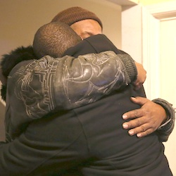 Melvin Jones, facing camera, hugs Robin Andrews, both brothers of Bettie Jones, 55, in Jones' living room after she was shot and killed by a Chicago police officer in Chicago on Saturday, Dec. 26, 2015. A Chicago police officer shot and killed Jones and a man while responding to a domestic disturbance call in the neighborhood on the city's West Side, police said. (Abel Uribe/Chicago Tribune)