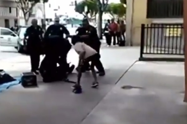 LAPD interact with Ezell Ford on Skid Row
