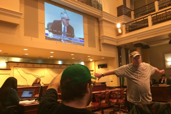 Protestor turns back on Mayor Hales following JTTF vote