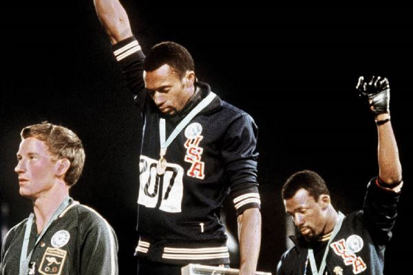 John Carlos raises Black Power fist at Olympics in 1968