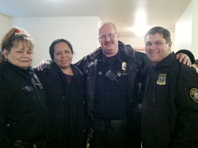 Portland Police Chief Larry O'Dea and staff with local resident