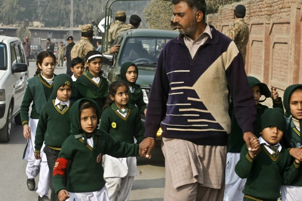 Pakistan man with school children