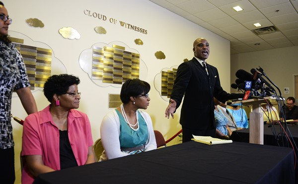 Cannon Lambert Sr. and family members at a news conference