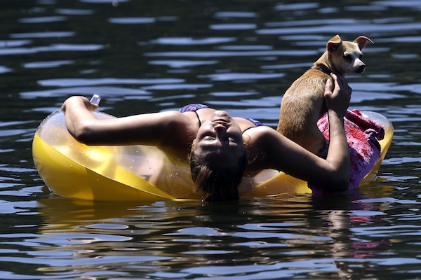 Justine Hicks and her dog, Kiana float on the Wllamette River