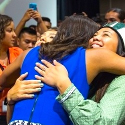 Michelle Obama gets hugs from Native American Youth at the first tribal youth summit