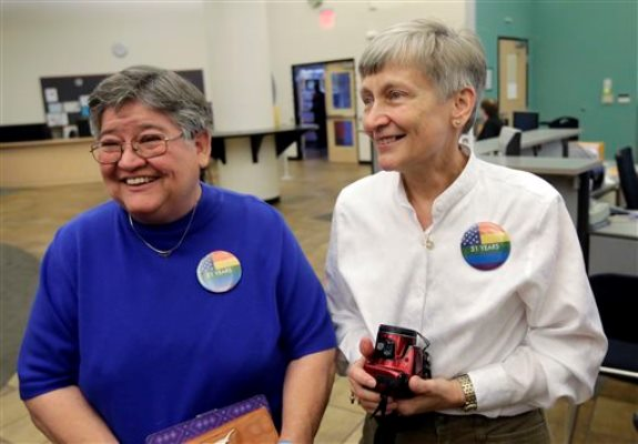 Carmelita Cabello, left, and her partner of 31 year, Jaque Roberts, right, arrive at the Travis County building for a marriage license