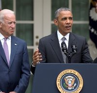 President Barack Obama, accompanied by Vice President Joe Biden, speaks in the Rose Garden of the White House