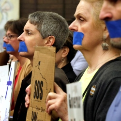 University of Wisconsin of Milwaukee associate professor Lorraine Malcoe, second from left, joins other angry educators