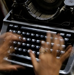 Journalist using a typewriter