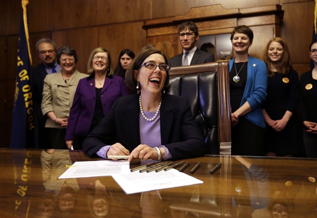 Gov. Kate Brown signs motor voter law