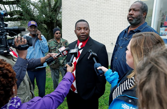 Marcus Turner speaks to reporters