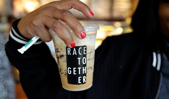 Starbucks customer holds a 'race cup'